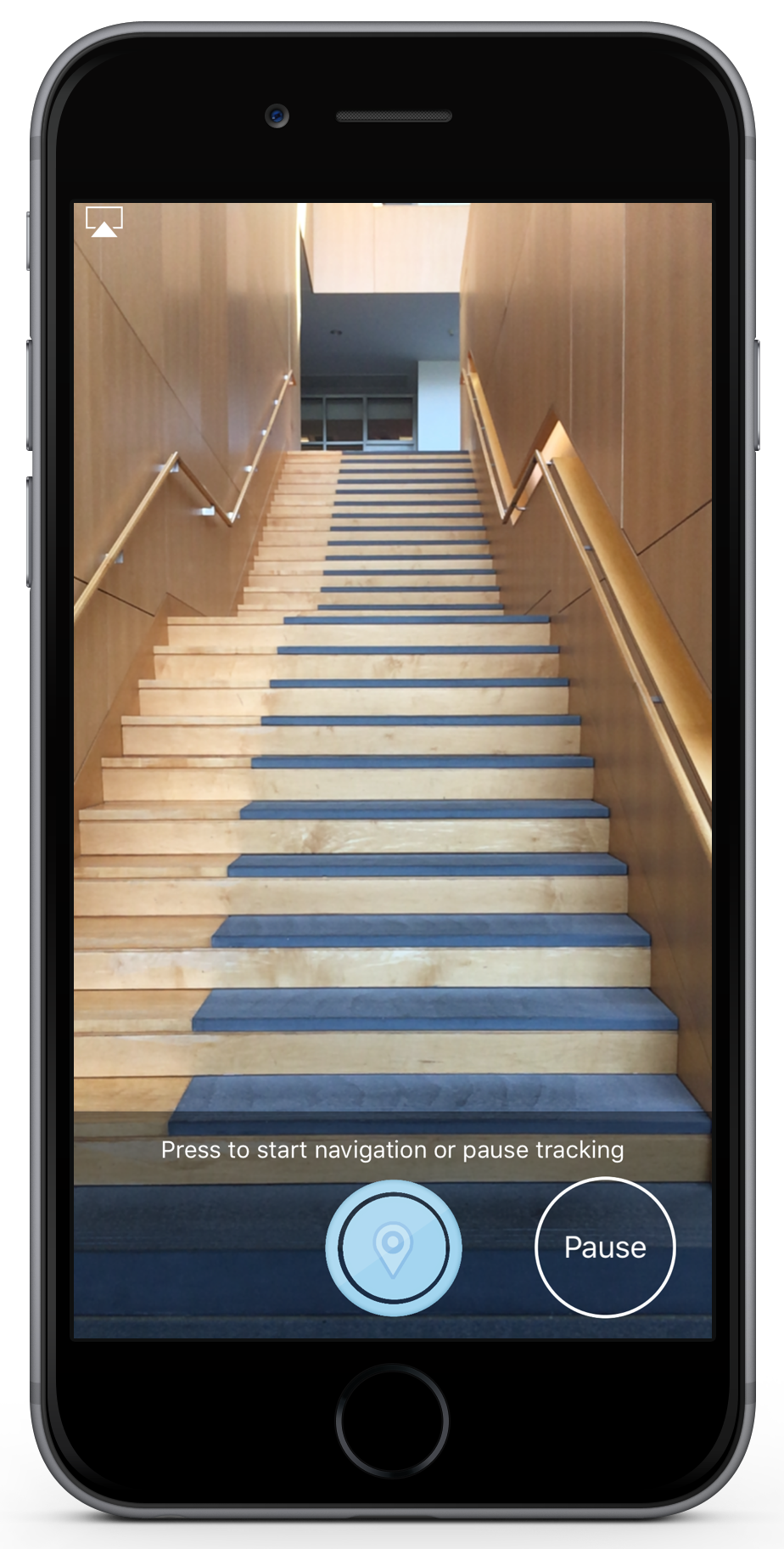 "a screenshot of the navigation feature.  The image shows a staircase.  There are two buttons.  The text says ""Press to start navigation or pause tracking."""