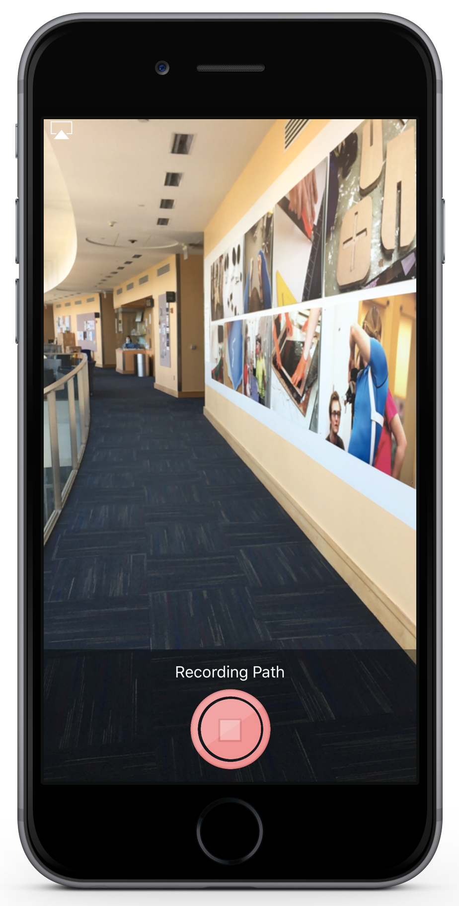 "a screenshot of the recording path feature.  The image shows a hallway.  At the bottom of the image is a button that says ""stop recording"""